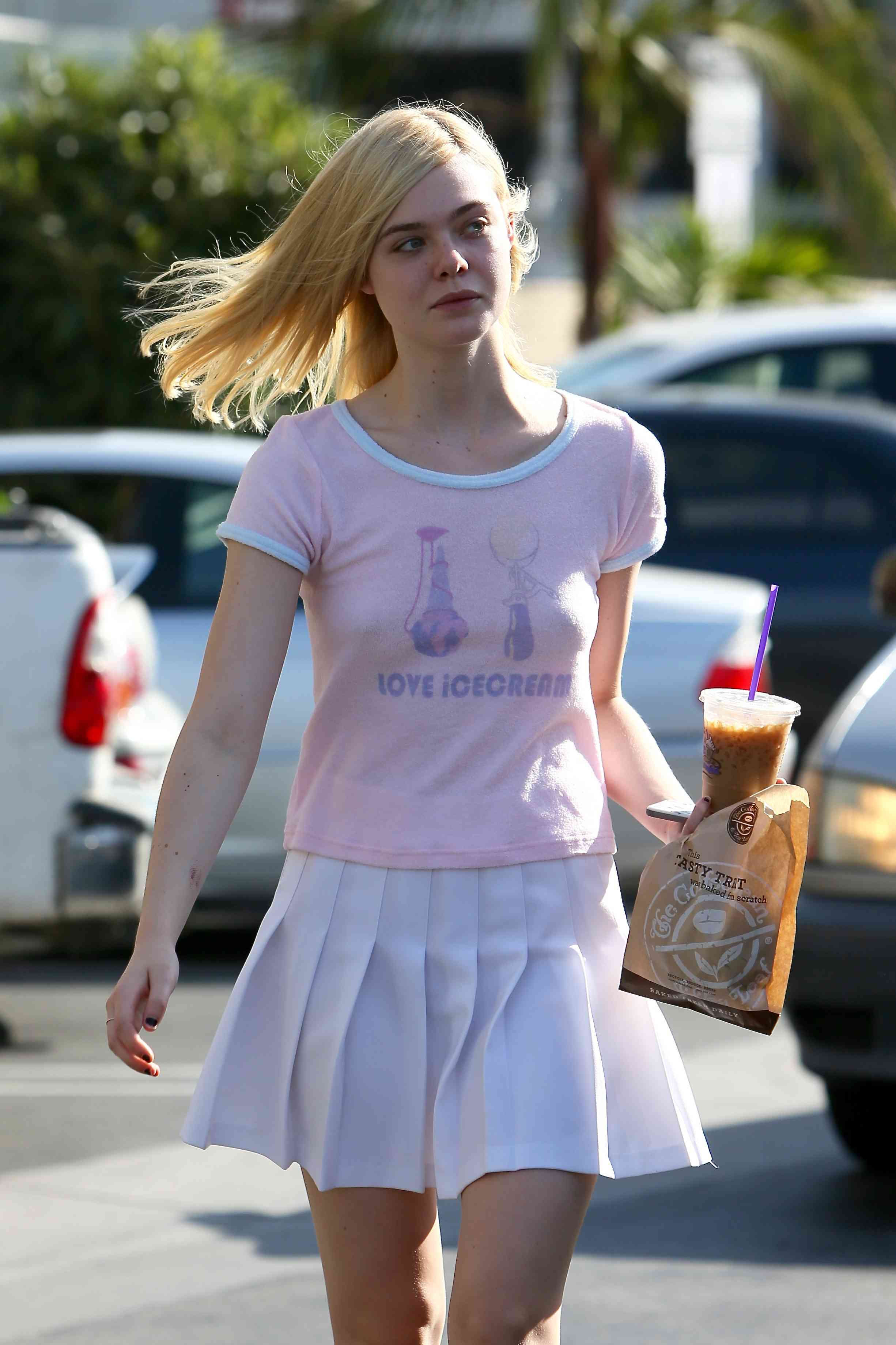 Elle Fanning picks up coffee and pastry